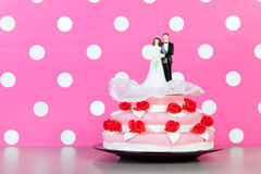 Couple on top of wedding cake Royalty Free Stock Photos
