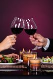 Couple tossing wine glass Stock Photography