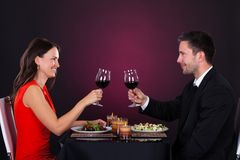 Couple tossing wine glass Stock Photos