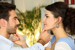 Couple touching each others faces Stock Image