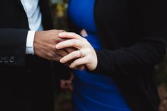 Couple touching hands Stock Images