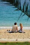 Couple on Toulon beach. Couple sitting on sandy beach in Toulon Royalty Free Stock Photos