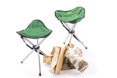 Couple of tourist chairs and firewood Stock Images