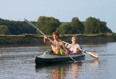 Couple of tourist kayaking along the river Stock Photography