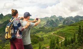 Couple tourist makes photo karst mountains. Royalty Free Stock Images