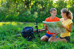 Couple tourist with map in hand in outdoors Royalty Free Stock Images