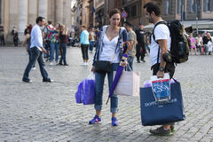 Couple tourist with shopping bags and backpack Stock Photos