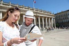 Couple with touristic map visiting Stock Photo