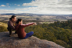 Couple of a tourists. Two travellers are enjoying the mountain lookout in Blue Mountains,NSW,Australia stock photo