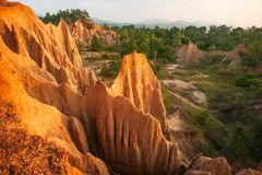 Couple tourists at ancient scenic landscape at sunset. The Sao Din Na Noi site displays picturesque scenery of eroded sandstone. Pillars, similar Canyon stock image