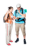 Couple of tourists arguing and looking for a path on a map Royalty Free Stock Photo