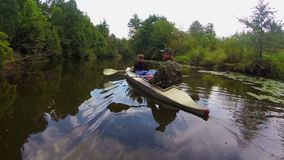 Couple of tourists boating on river, wild nature, active rest. Stock footage stock video