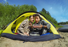 Couple of tourists in a camping tent Stock Photo