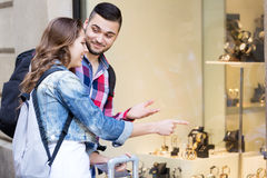 Couple of tourists choosing wristwatch Royalty Free Stock Photo