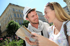 Couple of tourists with city map Stock Images