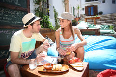 Couple of tourists discovering local food specialties Stock Image