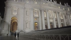 Couple of tourists enjoying night view of illuminated Saint Peter's Basilica. Stock footage stock video footage
