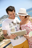 Couple of tourists in holidays on the seaside Stock Photography