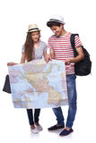 Couple of tourists looking destination on the map. Full length of young couple with travel suitcases looking a destination on the map, over white background Stock Photography