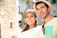 Couple of tourists with map in the street Royalty Free Stock Images