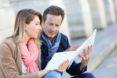 Couple of tourists with map and tablet in town Stock Image