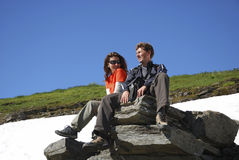 Couple of tourists in mountains Royalty Free Stock Image