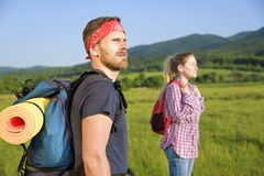 Couple of tourists on nature Stock Photography