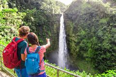 Free Couple Tourists Pointing At Hawaii Waterfall Royalty Free Stock Image - 156884096