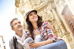 Couple of tourists relaxing by religious monument Stock Photography