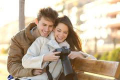 Couple of tourists reviewing photos in a dslr camera Stock Photo
