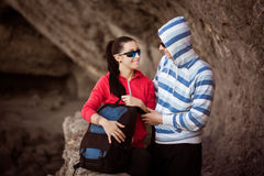 Couple of tourists in the rocky grot Royalty Free Stock Image