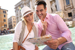 Couple of tourists in Rome. Couple reading city map by the Trevi Fountain of Rome Stock Image