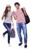 Couple of tourists screaming of joy. Full length of expressive young couple of tourists gesturing screaming of joy, over white background Stock Images