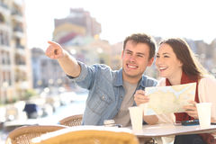 Couple of tourists searching destination during travel stock photos