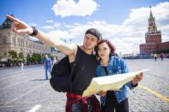 Couple tourists sightseeing city with map. Red Square, Moscow, R Stock Image