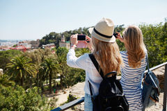 Couple tourists taking photo landscape with camera phone on park Royalty Free Stock Photography