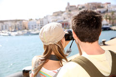 Couple of tourists taking photos of town's architecture Royalty Free Stock Photo