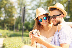 Couple of tourists taking pictures in the park Royalty Free Stock Images
