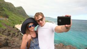 Couple tourists taking self portrait with camera phone on Hawaii, Oahu, Makapuu stock video