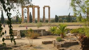 Couple of tourists taking selfie in territory of ancient Olympian Zeus Temple. Stock footage stock footage