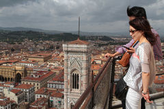 Couple of tourists on top of the Duomo. FLORENCE, ITALY, September 14, 2015 : Couple on top of the Duomo. Florence is considered the birthplace of the Stock Image