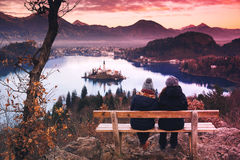 Couple of tourists travel Europe. Bled Lake, Slovenia. Couple of tourists travel Slovenia, Europe. Amazing view on Bled Lake. Winter landscape. Top view on royalty free stock images