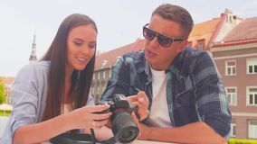 Couple of tourists traveling and exploring beautiful old town. Loving man and woman in a vacation trip. Couple of tourists traveling and exploring beautiful old stock footage