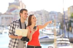 Couple of tourists traveling on vacation. Sightseeing pointing at landmarks stock image