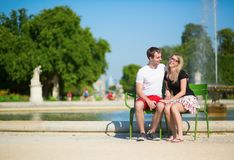 Couple of tourists in the Tuileries garden Royalty Free Stock Photo