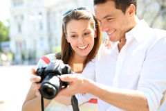Couple of tourists using photo camera Stock Images