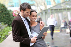 Couple of tourists using tablet in the streets Royalty Free Stock Photo