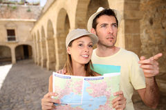 Couple of tourists visiting historical monuments Stock Photos