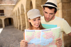 Couple of tourists visiting hostorical monuments Stock Images
