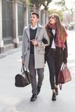 Couple of tourists walking down the street. Couple of tourists, a men and a woman, walking down the street in the city of Madrid, Spain stock photo
